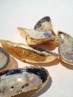 DIY //  empty oyster shells   spray glue   gold leaf = perfect for displaying jewelry