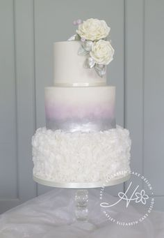 White Wedding Cakes Luxury white and silver wedding cake with watercolour and silver shimmer. - Hayley Elizabeth cake design specialises in bespoke wedding cakes, dessert tables, wedding sweet table Crazy Wedding Cakes, Sweet Table Wedding, Different Wedding Cakes, Purple Wedding Cakes, Wedding Cake Rustic, Fall Wedding Cakes, Wedding Cake Decorations, Wedding Cakes With Flowers, Elegant Wedding Cakes