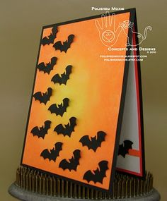This colony of bats flies on a sponged card, with a stray bat on the inside of the card on this handmade Halloween card.