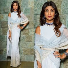 Reception Ready Tarun Tahiliani Shilpa Shetty in a stardust ice blue draped saree from Tarun Tahiliani is proof of why it works! That handcrafted Bharany's choker necklace set with matching sapphire earrings are divine. Indian Designer Outfits, Indian Outfits, Designer Dresses, Indian Clothes, Designer Sarees, Saree Wearing Styles, Saree Styles, Dress Styles, Indian Gowns