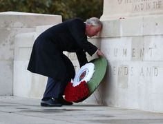 Prince Charles Photos Photos - Prince Charles, Prince of Wales lays a wreath at the Guard's Memorial for the Welsh Guards' Regimental Remembrance Sunday on Horse Guards Road on November 13, 2016 in London, England.  The Queen, senior politicians, including the British Prime Minister and representatives from the armed forces pay tribute to those who have suffered or died at war. - The Royal Family Lay Wreaths at the Cenotaph on Remembrance Sunday