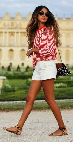 Red and white tshirt, small white short and chocolatte black and white bag street style