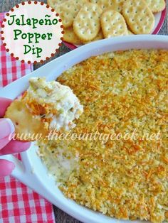 Jalapeño Popper Dip - only the most AMAZING dip recipe ever for any holiday party or football party. Creamy with a crunchy topping. www.thecountrycook.net