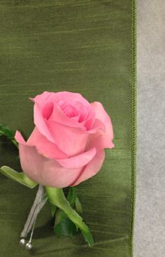 Medium pink rose boutonniere with gray stem wrap for an Ombre' wedding. Boutonniere by Seasonal Celebrations. http://www.seasonalcelebrations.com