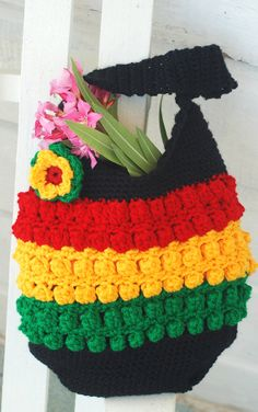 Crochet Rasta Inspired Shoulder Bag In Dread by CaribbeanSpirit, $39.00 It includes a lovely crochet flower which is fastened with a simple hair needle - so you can wear it in your hair if you wish. Material: 100% durable acrylic. Colors: rasta colors - red, gold and green + black