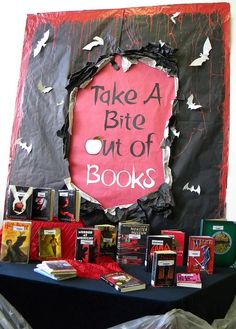 "Vampire-related display that looks to be similar in nature to the Graphic Novels poster. The theme is good, but the ""bite"" doesn't seem quite right. A good idea that you could run with, though!"