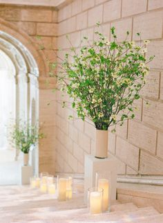 #candles #staircase the entrance to the Asian Art Museum decorated with blooming dogwoods and candles | Photography by josevillaphoto.com | Event and Floral Design by kathleendeerydesign.com | Planning by lauriearons.com |   Read more - http://www.stylemepretty.com/2013/07/25/kathleen-deerys-san-francisco-wedding-from-jose-villa/