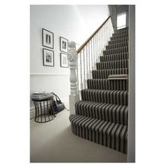 Having a different carpet for the staircase adds simple interest to a hallway :)