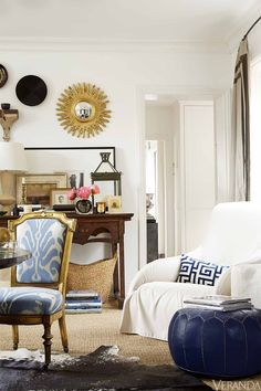 Treasured mementos on an 18th-century Chinese desk personalize the space.  Armchair slipcovered in a Great Plains fabric, B&B Italia; pillow in a Clarence House fabric; pouf, John Derian.   - Veranda.com