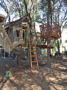 tree house features a tire swing, fireman's pole, ladder, lookout tower and net lounger for relaxing after all that swinging, sliding and climbing.
