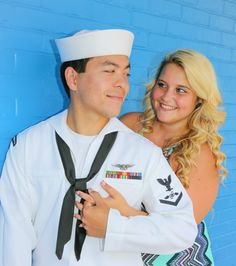 Navy husband & wife had family pictures done prior to his deployment at Jacksonville Florida beach ... She wore bright colors to compliment his uniform ... There son was incorporated into some pictures with his beautiful blue eyes ... & we used a famous blue wall! And can't forget they got to dance in the streets 😍