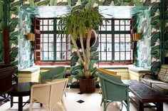 """Indochine-Restaurant NYC - """"The Original"""" Martinique Banana Leaf wallpaper, which was created by decorator Don Loper in 1942 for the Beverly Hills Hotel, has since developed an iconic status amongst the design world."""