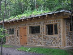 "Sebastien Demers built a beautiful two story cordwood home near Ste. Onesime, Quebec in Here are some pictures and an explanation of ""the build"" from Sebastien himself. Natural Building, Green Building, Cabins In Wisconsin, Cordwood Homes, Wood Shed, High Walls, Interior Garden, Wooden House, Little Houses"