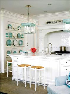 I love this look.  Glossy white subway tiles, and the turquoise accents = LOVE.  So clean looking.