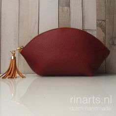 Leather zipper pouch with tassel