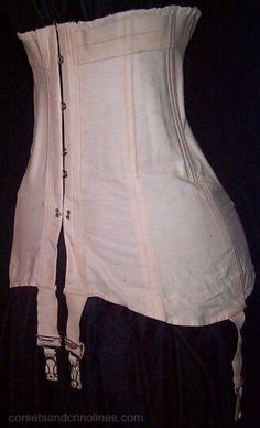 """C.1910-1915. A light pink coutil corset. Most of the corsets from the era were made in white coutil. There is pink elastic around the top of the corset which is gathered to make ruffles. The corset has 4 suspenders for stockings. 'Warner's No.42 Double Boning Rust Proof Corsets' is stamped on the inside as is '24'. Measures 23"""" around the top of the corset and measures about 26"""" at waist level, approx. 36"""" in the hips. Measures almost 17"""" long and comes well down over the hips."""