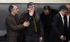 Editor-in-chief of French satirical weekly Charlie Hebdo Gerard Briard (l) lookis on as French cartoonist Renald Luzier, aka Luz, blows a kiss.