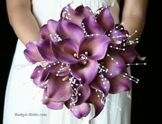 Purple calla wedding bouquet. Nix the white bead things and we're good!