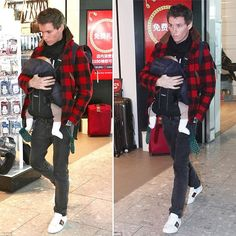 #IrisMary! Do we spot a red mane?#EddieRedmayne carries his baby girl through @heathrow_airport Wednesday. He was later spotted on a flight to Munich.