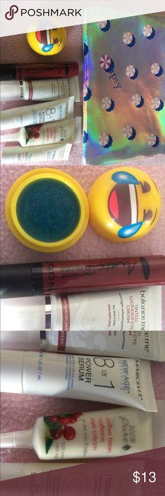 Make up bundle with bag. Lip glosses, eye cream and face serum. Makeup
