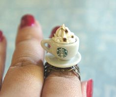 This ring feature a miniature cup of Starbucks coffee that is securely attached to an adjustable filigree ring that fits most ring sizes. The coffee cup measures about 1.5 cm tall. SKU 1515