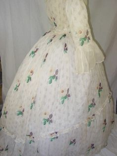 Antique morning gown/ overdress…    c. 1850-60  Shown with hoop skirt…  Material is an ethereal ivory-white gauze, with a divine print of flowers and leaves…