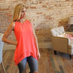 "Neon coral gold neckline tiered tunic Modeling size small, 65% cotton 35% polyester.  Bust laying flat: XS 18"" S 19"" M 20"" L 21"" XL 22"". Length XS 25/33, S 26/33"", M 27/34, L 28/35"" XL 29/36""  All listings should have updated sizes available in the listing. I discount bundles of two+ items.  RS875-1231 Tops Tunics"