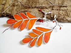Hey, I found this really awesome Etsy listing at https://www.etsy.com/listing/205625218/orange-autumn-leaves-stained-glass