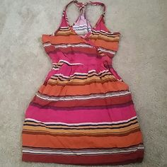 Cute striped halter top Bright pink, blue, orange, burnt yellow, beige, and maroon colors, top has small pockets in the front Lush Tops