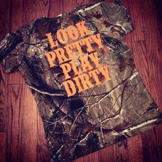 Our look pretty play dirty slogan is printed on a 100% ring-spun cotton Realtree camo tee.  These tees are now **women's cut**.    -Look Pretty Play Dirty printed on back of tee -2% of all Code V sales are donated to Children of Fallen Soldiers Relief Fund, Inc. and Fisher House