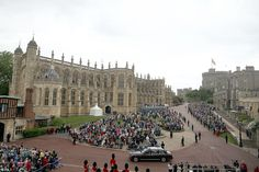 Spectacle: Crowds of well-wishers waved as the Royal Family drove past them in cars on their way to St. George's Chapel for the annual Order of the Garter Service. - 13 June 2016.