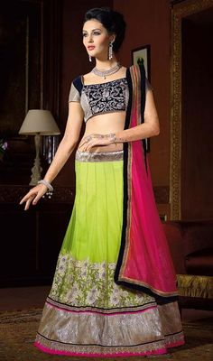Redefine style with this choli skirt in green color embroidered net. The ethnic lace, stones and resham work over a dress adds a sign of elegance statement for the look. #netlehengacholie #womenlehengacholis #lehengaskirtcholicollection