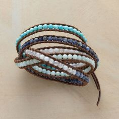 """BLUE UPON BLUE 5 WRAP BRACELET--Chan Luu stitches long spans of turquoise, sodalite, amazonite and lace agate amid lengths of leather cord. Handmade with sterling silver button closure. 32"""" to 34""""L."""