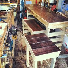 Here's a matching set of tables we built recently from pallets and leftover hardwood flooring.