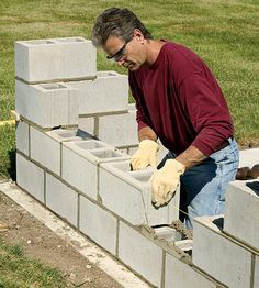 to Build a Concrete Block Wall Bring privacy to your backyard with a DIY concrete block wall. Our step-by-step instructions will show you how.Bring privacy to your backyard with a DIY concrete block wall. Our step-by-step instructions will show you how. Concrete Block Walls, Cinder Block Walls, Concrete Patio, Concrete Footings, Cinder Blocks, Concrete Building Blocks, Concrete Design, Brick Laying, Casas Containers