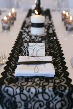 Table decor  white tables, black runner (crinkle fabric?)
