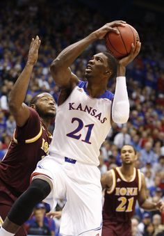 Kansas center Joel Embiid takes off to the bucket against Iona forward David Laury during the first half on Tuesday, Nov. 2013 at Allen Fieldhouse. Kansas Jayhawks Basketball, Ku Basketball, Best Basketball Shoes, Go Ku, Final Four, Finals, Photo Galleries, Wide Feet, Tuesday