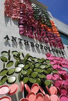 Anthropologie repurposes colourful plastic plates as giant garland outside their shop. #visual_merchandising #repurpose: