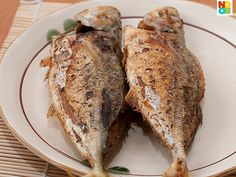 Step-by-step photos of my mum's pan-fried fish with stuffed chilli recipe.