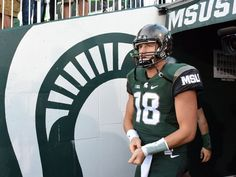 Michigan State quarterback Connor Cook surveys the