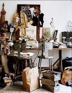 I know this is supposed to represent clutter, but there's something about it that draws me in and makes me want to look at all those wonderful raw materials and bits of artwork. Love the urban color palette.