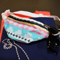 You found it, the most adorable fanny pack! This exclusive desden deisgned tribal pattern fanny pack allows you to keep your hands free while you cheer on your team or party on the beach! USA Made