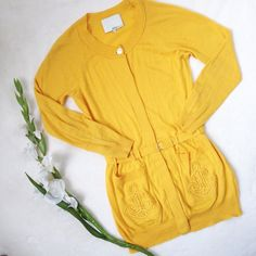 """3.1 PHILLIP LIM Anchor Belted Lightweight Cardigan Beautiful lightweight cardigan in a mustard yellow. Belted waist and anchor design on pockets. Button closure but only top button shows. 50% wool 50% cotton dryclean only. Approx flat meas: length 29.5"""", sleeves 21.5"""", chest 17"""", waist 15"""". *NOTE this is in good used condition with a small marking and small snag on the left sleeve. Pilling on sweater. 3.1 Phillip Lim Sweaters Cardigans"""