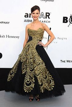 Georgina Chapman in her own Marchesa glided ball gown. I love the gold peacock design, what a masterpiece.