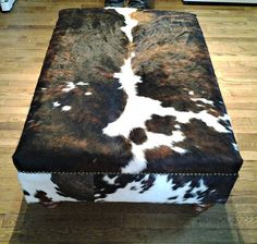 Genuine Cow Hide Cowhide Ottoman Footstool Bench by FurnitureLegs EAST COAST LEATHER 130 Kingfisher Road, Mount Cotton QLD 4165 Leather Wholesaler Specialise in furniture Source upholstery from Italy and Austria. Cowhide Decor, Cowhide Furniture, Cowhide Ottoman, Ottoman Footstool, Table Furniture, Handmade Ottomans, Living Room Wall Units, Chair Bench, Cow Hide Rug