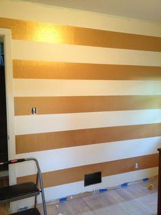 Gold stripe wall in nursery.