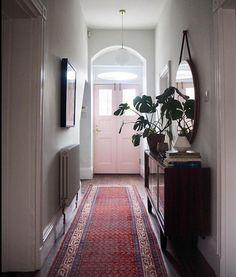 Revamped hallway, pink door, Persian rug. Mirror from West Elm. Pink Hallway, Hallway Colours, Upstairs Hallway, Edwardian Hallway, Pink Persian Rug, Unwanted Furniture, Second Hand Furniture, Small Hallways, Hallway Decorating