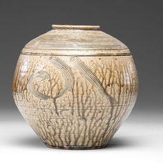 "Bernard Leach (1887-1979; Hong Kong/Britain), Ash Fired Vase with Rake Design, ca. 1960s, stoneware; 10.5″ x 9.5,"" artist stamps on side."