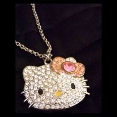 Hello Kitty Big Kitty Necklace This beauty features a large, flat back, Hello Kitty. Covered with clear rhinestones and a pretty pink bow; this necklace is a real attention getter! The chain included is shorter and the pendant rests slightly below the collar bone. Hello Kitty Jewelry Necklaces