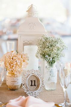 Simple vintage centerpiece with baby's breath in lace wrapped jar and burlap framed table number. @myweddingdotcom